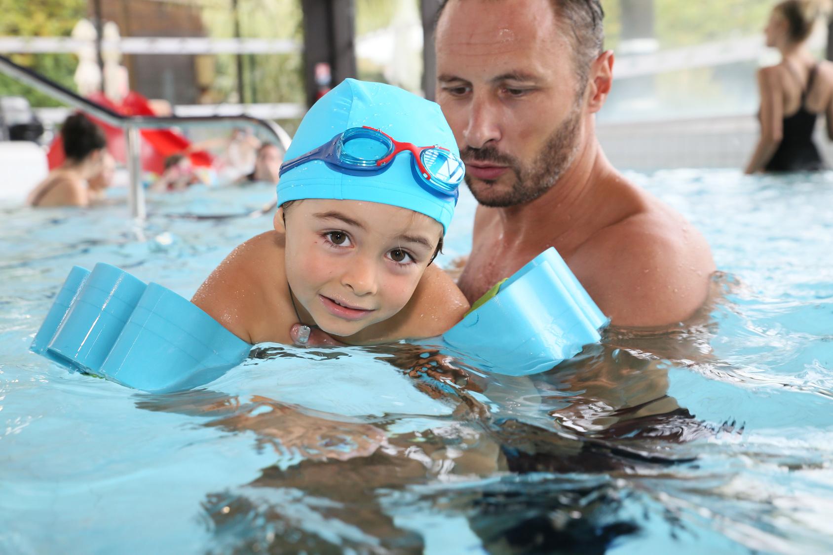 little-boy-learning-how-to-swim